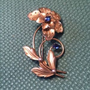 Sterling flower brooch with blue stones